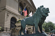 Felines Photo Prints - Bronze Lions Stand Guard Over The Art Print by Paul Damien
