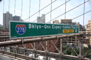 Queens Apartments Prints - Brooklyn Bridge Road Signs Print by Frank Romeo