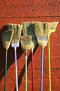 Leaning Posters - Brooms leaning against wall Poster by Garry Gay