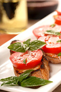 Olive Snacks Framed Prints - Bruschetta with tomato mozzarella and basil with a glass of win Framed Print by David Smith