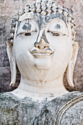 Asian Sculptures - Buddha face close up by Chatuporn Sornlampoo