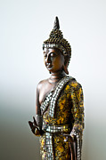 Enlightenment Posters - Buddha statue with a golden robe Poster by Ulrich Schade
