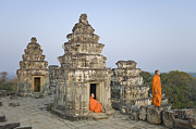 Religious Dress Framed Prints - Buddhist Monks Amongst Temple Ruins Framed Print by Martin Puddy