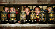 Shirt Digital Art Originals - Buddhist monks in red robes look out of the prayer wheels with m by Max Drukpa