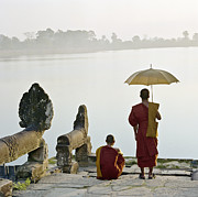 18-19 Years Prints - Buddhist Monks Standing On Waters Edge Print by Martin Puddy