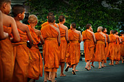 Red Robe Originals - Buddhist monks walking along the street during the daily ritual  by Max Drukpa