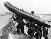 Us Navy Photos - Buds Students Carry An Inflatable Boat by Michael Wood