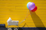 Plaything Photo Prints - Buggy and yellow wall Print by Garry Gay