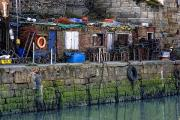 Boathouses Photos - Buildings Along Waterfront And Sea by John Short