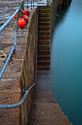 Fishing Trawler Framed Prints - Buoys on railings with steps. Framed Print by Richard Thomas