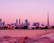 Sand And Sea Posters - Burj Khalifa previously Burj Dubai At Sunset Poster by Chris Smith