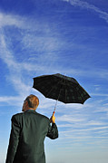 Concentration Framed Prints - Businessman looking at sky holding umbrella Framed Print by Sami Sarkis