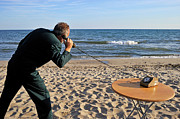 Concentration Prints - Businessman on beach with Landline Phone Print by Sami Sarkis