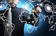 Touch Screen Posters - Businessman touching world map screen Poster by Setsiri Silapasuwanchai