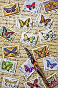 Pen Prints - Butterfly stamps and old document Print by Garry Gay