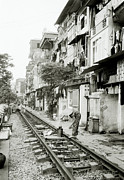 The Ghetto Prints - By The Tracks In Hanoi Print by Shaun Higson