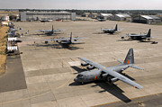 Airfield Prints - C-130 Hercules Aircraft Stationed At An Print by Stocktrek Images