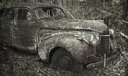 Abandoned Cars Prints - Camouflage Classic Car Print by John Stephens