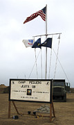 Billboard Signs Prints - Camp Peguero Sign And Central Flag Pole Print by Michael Wood