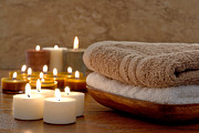 Glowing  Posters - Candles and Towels in a Spa Poster by Olivier Le Queinec