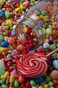 Glass Jar Posters - Candy jar spilling candy Poster by Garry Gay