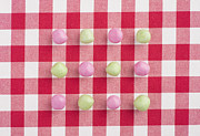Table Cloths Posters - Candy on a red and white chequered tablecloth Poster by Lars Hallstrom