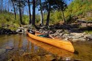 Canoe At Portage Landing Print by Larry Ricker