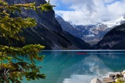 Alberta Rocky Mountains Photos - Canoe on Lake Louise by Larry Ricker