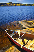 Lake Prints - Canoe on shore Print by Elena Elisseeva