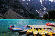 Azure Prints - Canoes at Moraine Lake Print by Frank Wicker