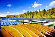 Row Boat Prints - Canoes on autumn lake Print by Elena Elisseeva