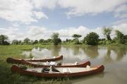 Riversides Prints - Canoes On The Lower Zambezi Print by Axiom Photographic