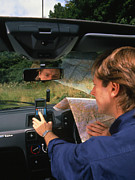 Gps Framed Prints - Car Driver Using Hand-held Gps Receiver Framed Print by David Parker