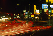 Hotels And Resorts Framed Prints - Car Light Streaks Along A Busy Highway Framed Print by Phil Schermeister