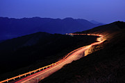 Railing Prints - Car Light Trail In Mountain Highway Print by Samyaoo