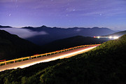 Railing Prints - Car Light Trails And Star Trails At Night Print by Samyaoo