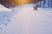 Snow-covered Landscape Prints - Car on Snow Covered Road Print by Jeremy Woodhouse