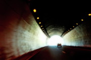 Tunnels Framed Prints - Car travelling inside a highway tunnel Framed Print by Sami Sarkis
