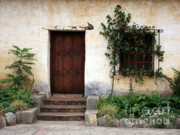 Stucco Framed Prints - Carmel Mission Door Framed Print by Carol Groenen