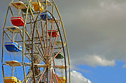 Carnival Ride Posters - Carnival Ride on Cloudy Day Poster by Carolyn Marshall