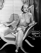 Pajamas Posters - Carole Lombard, Sitting, In A 1930s Poster by Everett