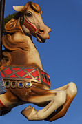Carrousels Prints - Carousel horse against blue sky Print by Garry Gay