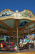Contemplating Framed Prints - Carousel ride Framed Print by Sami Sarkis