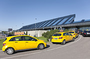 Airport Architecture Prints - Cars Lining Up For Pickup at the Airport Print by Jaak Nilson