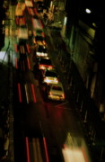 Locations Framed Prints - Cars travelling along a street during a rainy night Framed Print by Sami Sarkis