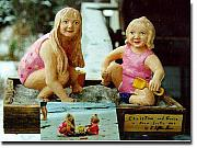 Children Sculptures - Carved portrait of two girls playing on the beach. by Clifton Sears