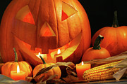 Agriculture Posters - Carved pumpkin with candles Poster by Sandra Cunningham