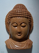 Spiritual Art Sculpture Prints - Carved sandalwood buddha Print by Suhas Tavkar