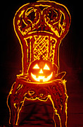 Jack-o-lantern Posters - Carved smiling pumpkin on chair Poster by Garry Gay