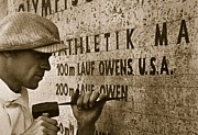 Sprinting Prints - Carving the name of Jesse Owens into the champions plinth at the 1936 Summer Olympics in Berlin Print by American School